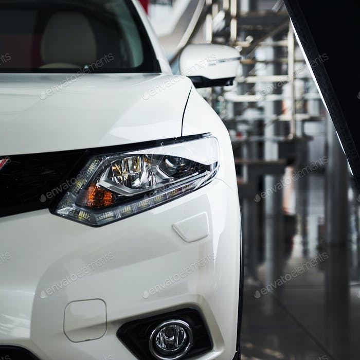The headlights and the hood of a new luxury car