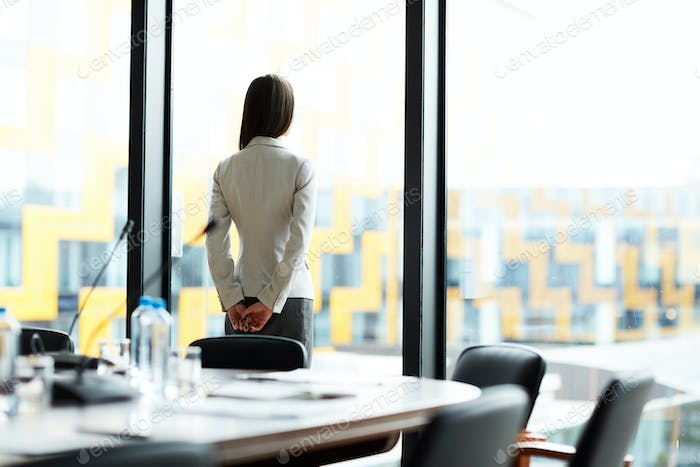 Pensive Businesswoman in Office