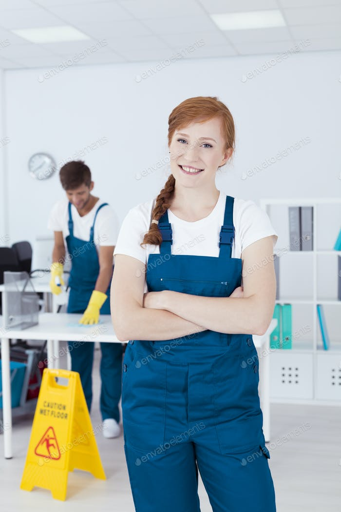 Smiling cleaner in office