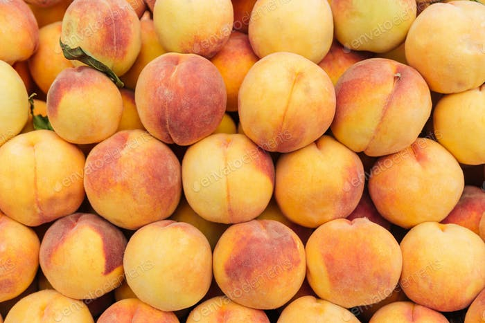 Fresh ripe peaches background