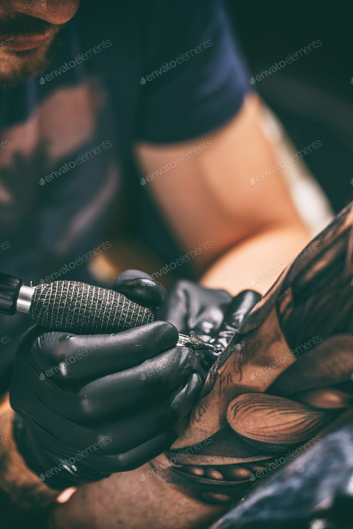 Tattoo artist creating a tattoo