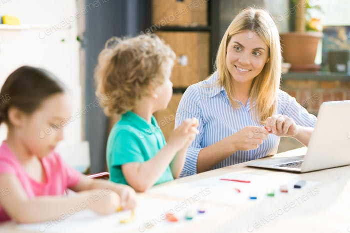Art teacher with children