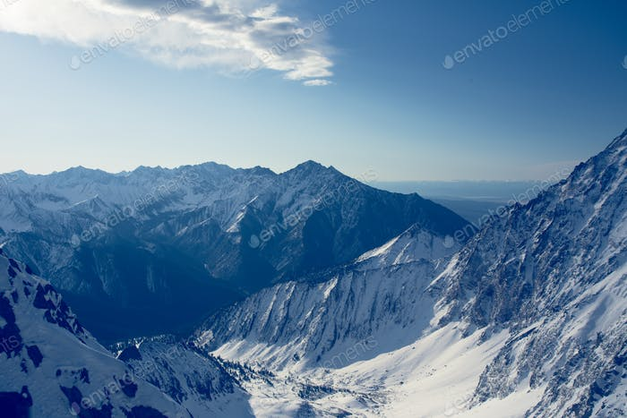 Winter landscape of mountains. Snow-covered mountains. Beautiful