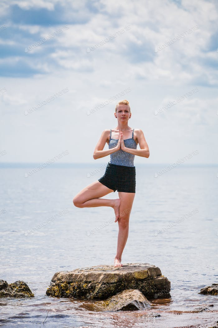Young Woman doing Yoga Tree Position