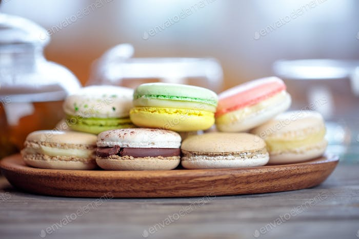 Close-up of colorful macaron (macaroon) on the table with hot te