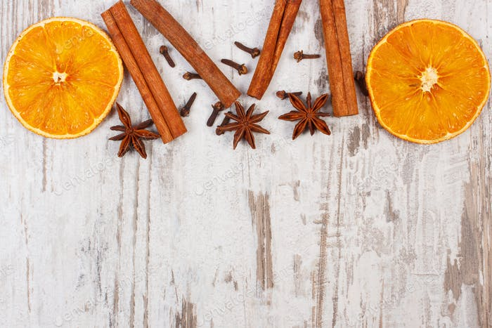 Dried orange with spices on old wooden background, christmas decoration