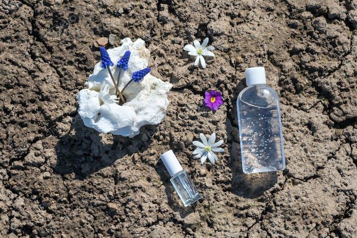Bottle of antiseptic gel in grass.