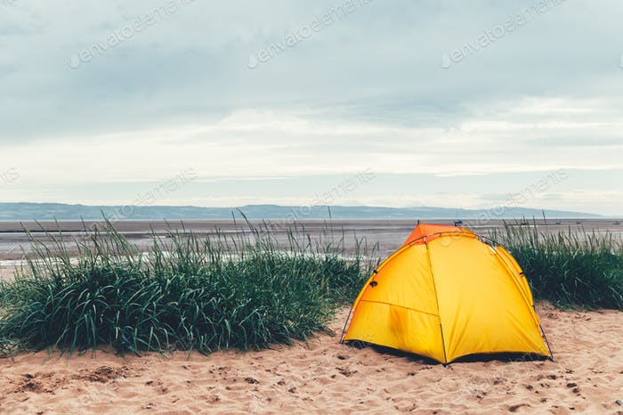Bright Yellow Tent on the Beach