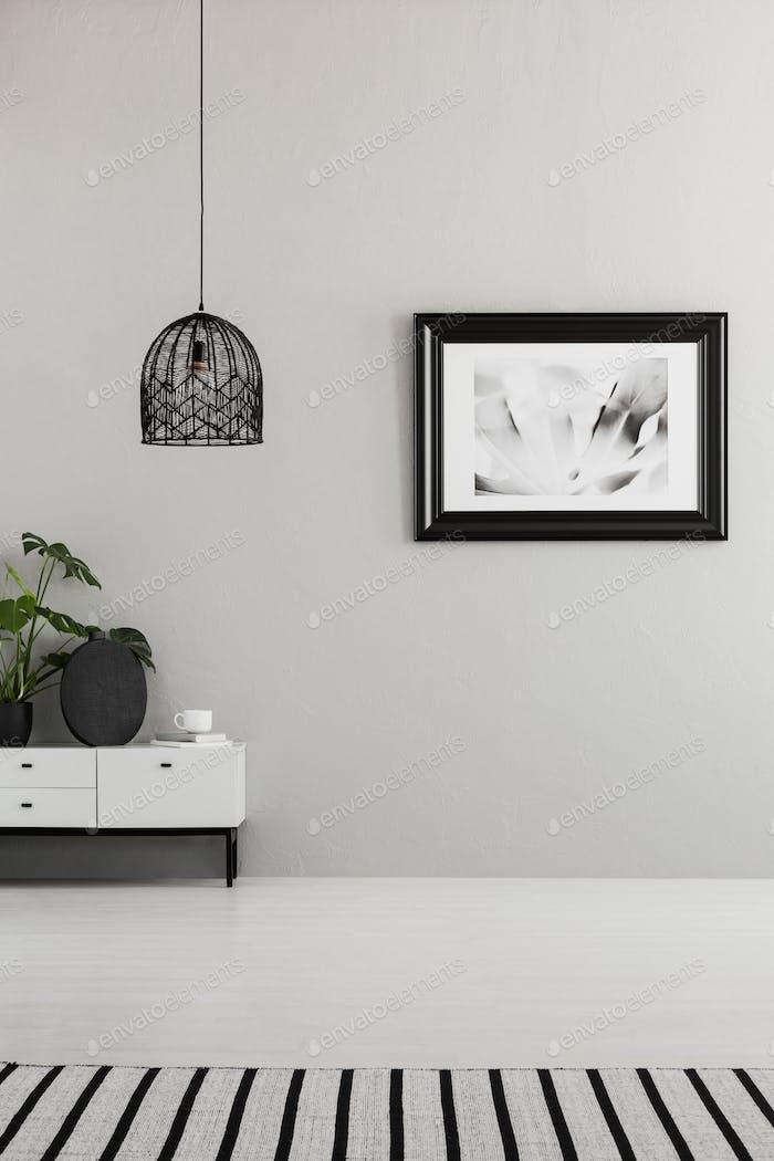 Classy, monochromatic living room interior with a creative ceili