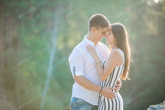 Young couple going to kiss outdoors