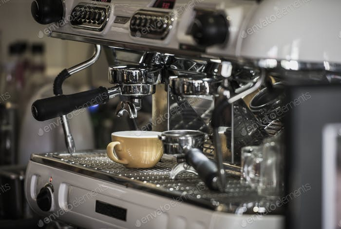 Coffee machine with coffee cup at cafe