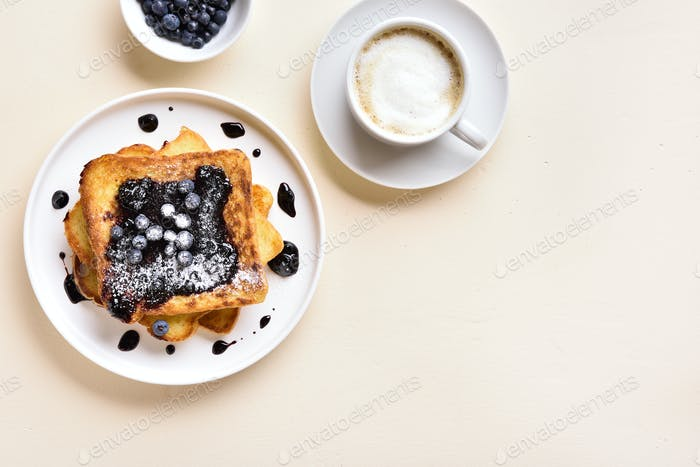 French toasts with blueberry sauce