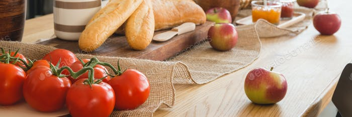Panorama and close-up on tomatoes and apples on wooden table in