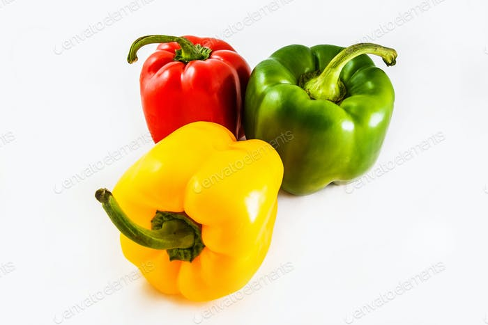Fresh peppers. Three sweet Red, Yellow, Green Peppers isolated on white background.