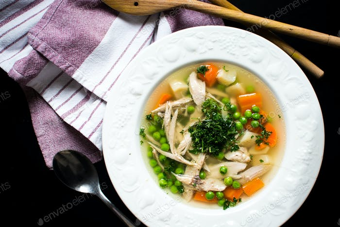 Homemade chicken broth with vegetables