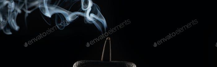 Burning Incense on Stone With Smoke on Black Background, Panoramic Shot