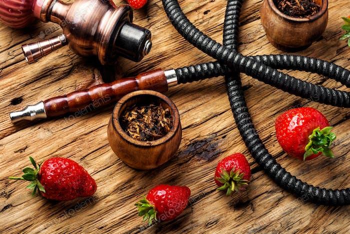 Smoking hookah on strawberry
