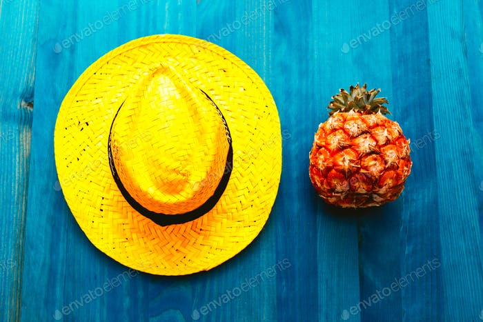 Pineapple and straw hat. Beach cocktail. Tropical Minimal. Fresh