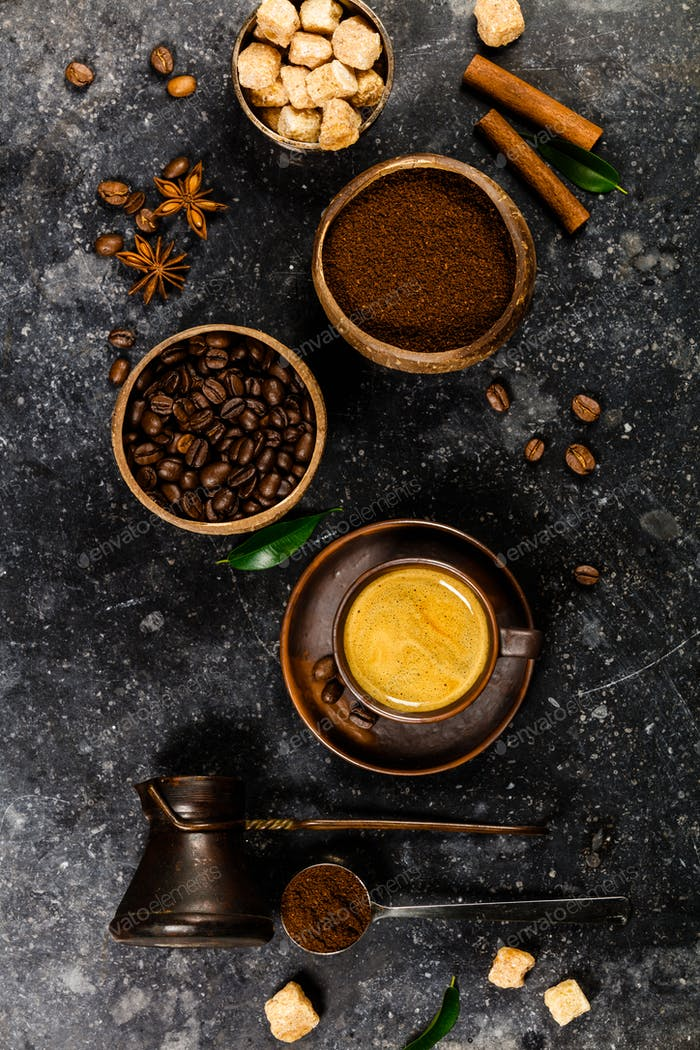 Creative flat lay with milled coffee, coffee beans, brown sugar and espresso