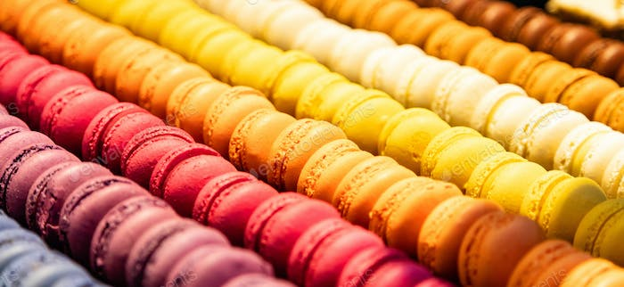 Macarons assortment background texture. Store showcase close up view with details