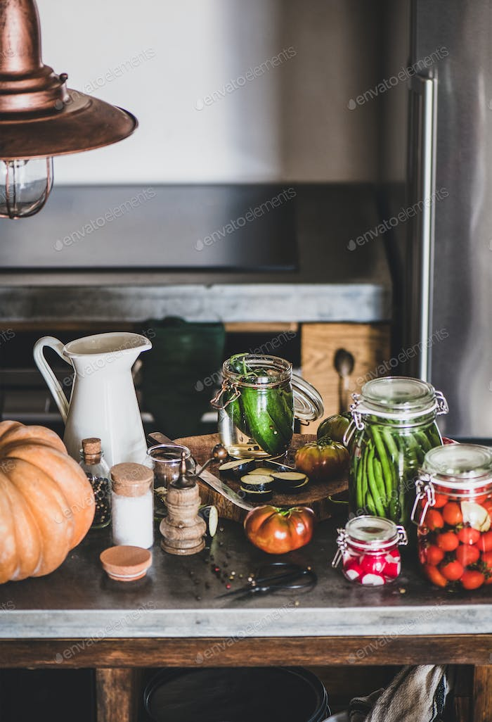 Ingredients and jars with homemade vegetables preserves