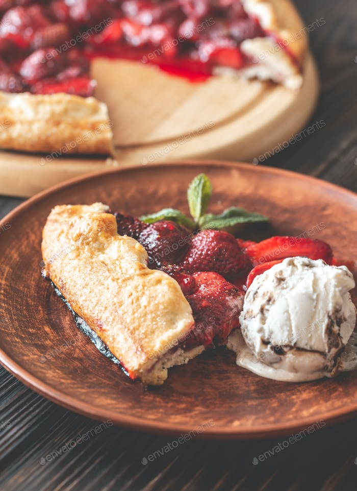 Slice of strawberry galette with ice-cream