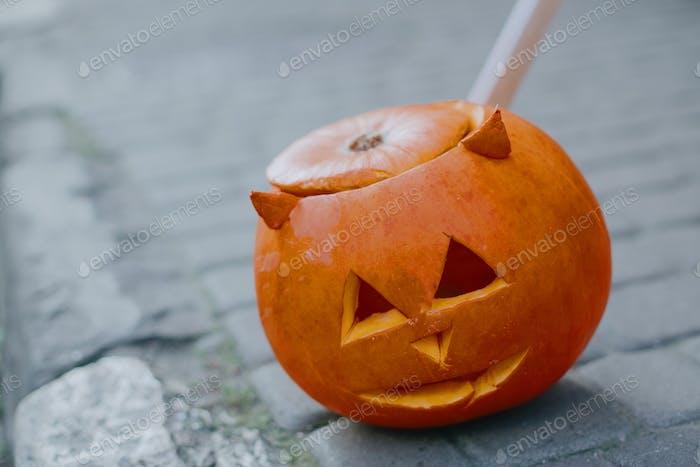 Jack-o'-lantern with scary face on street, modern festive decoration