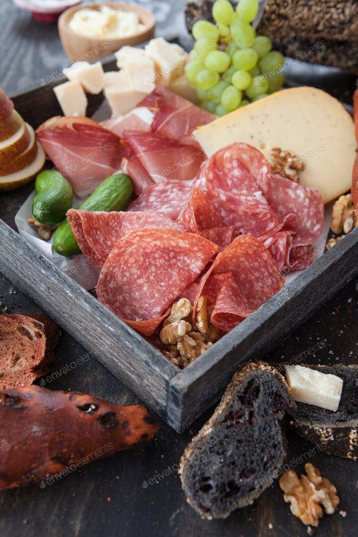 Variety of salami and cheeses
