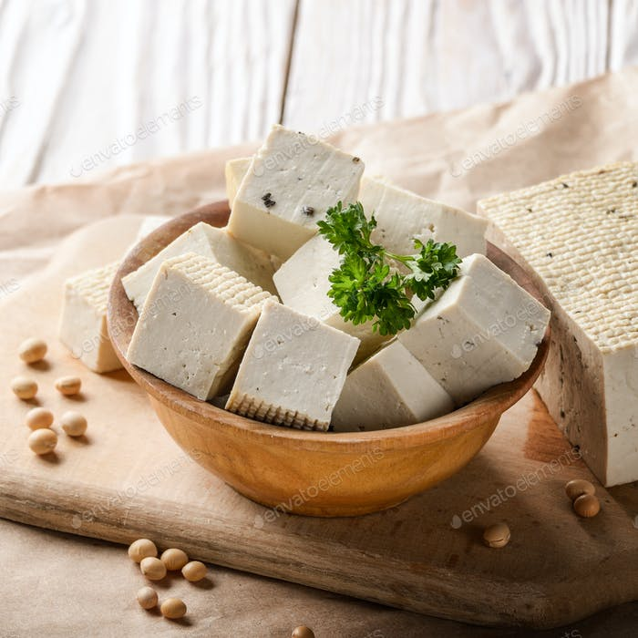 Soy Bean curd tofu in wooden bowl on kitchen table. Non-dairy al