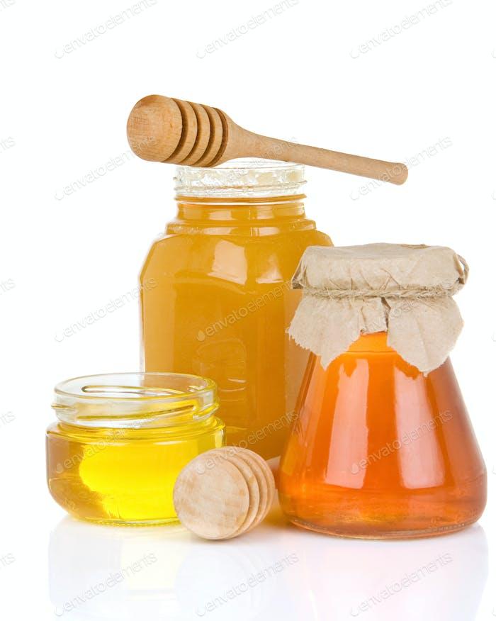 Glas voller Honig und Stick