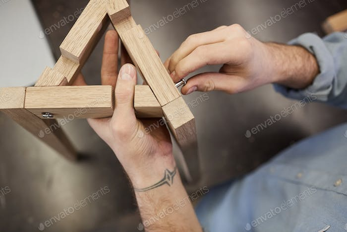 Man making wooden figure