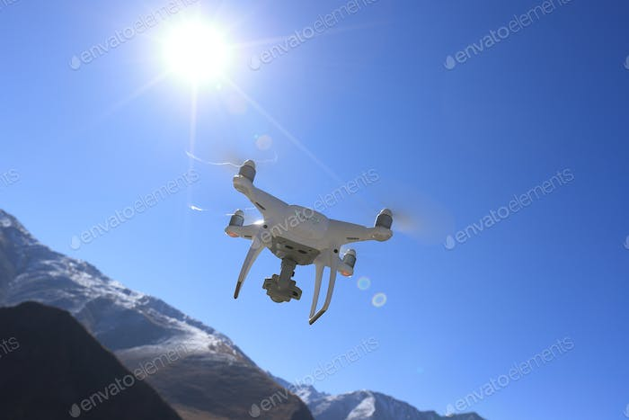 Flying drone taking picture of high altitude mountains in Tibet,China