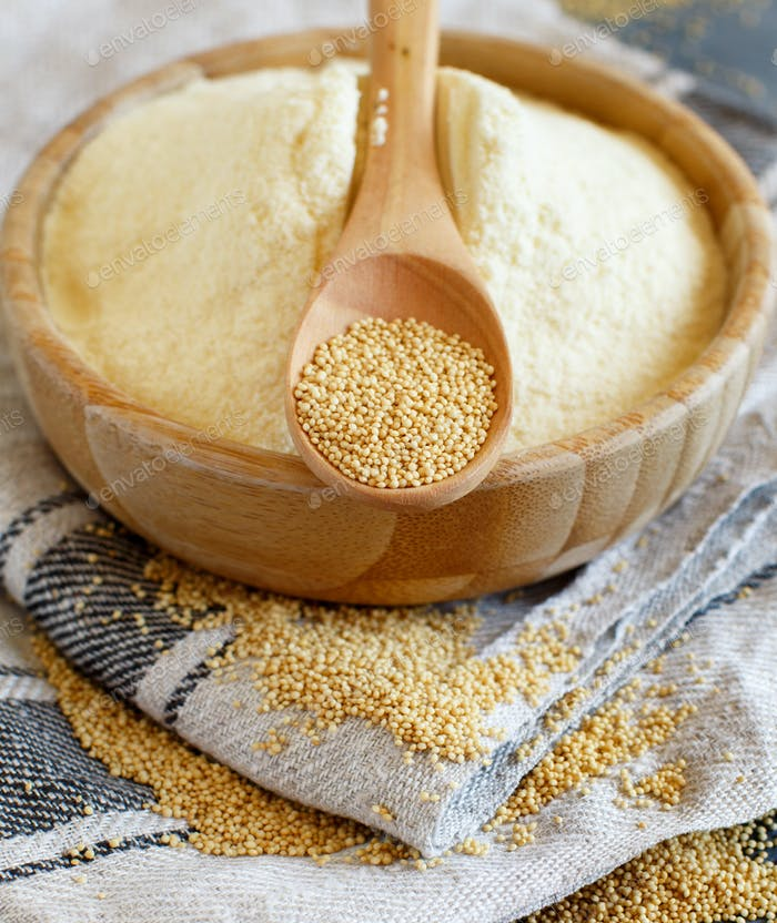 Bowl of raw Amaranth flour with a spoon of Amaranth seeds