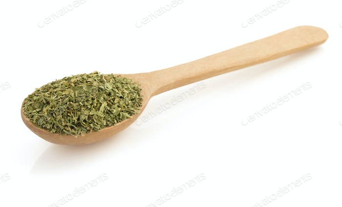 dried green spices in spoon on white