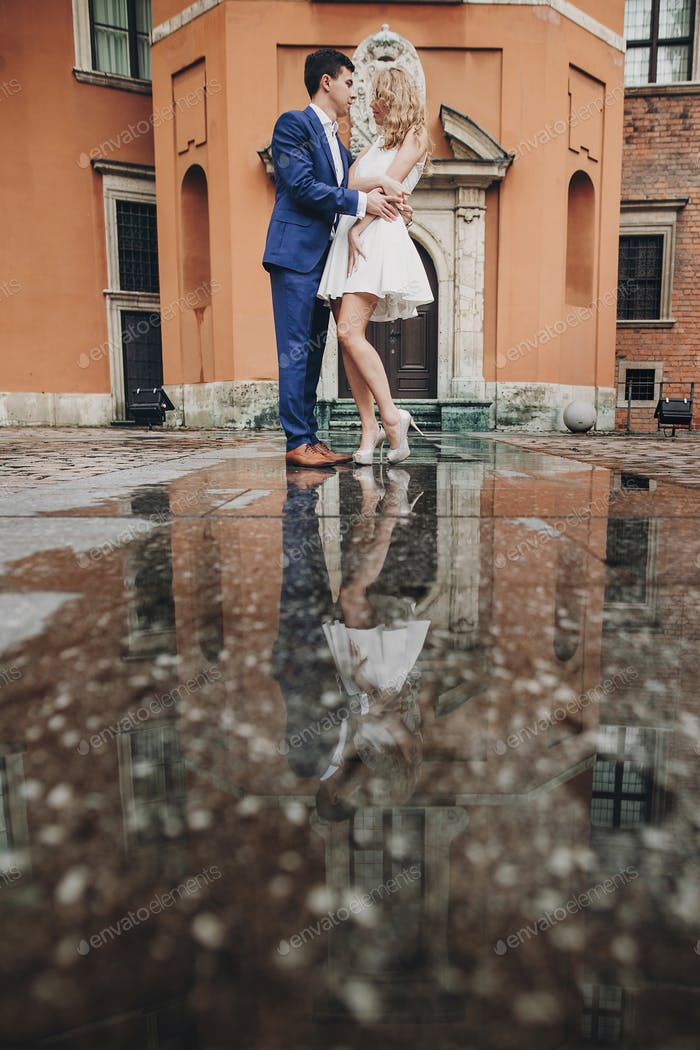 Stylish couple dancing in european city street