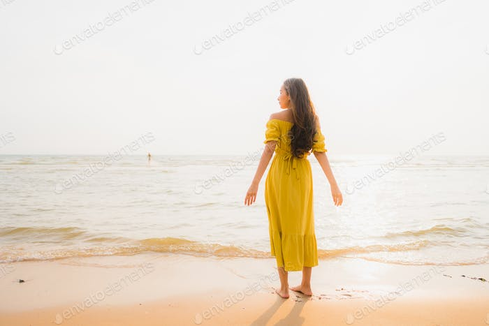Portrait beautiful young asian woman walk on the beach and sea o