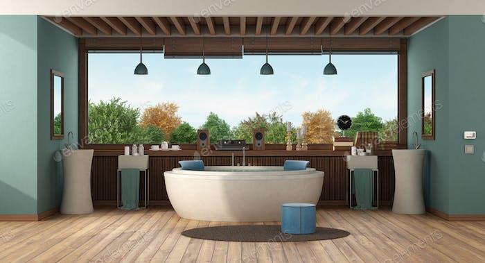 Green luxury bathroom with round bathtub