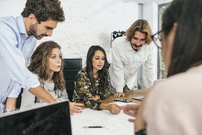 Young team of coworkers making great work discussion in modern c