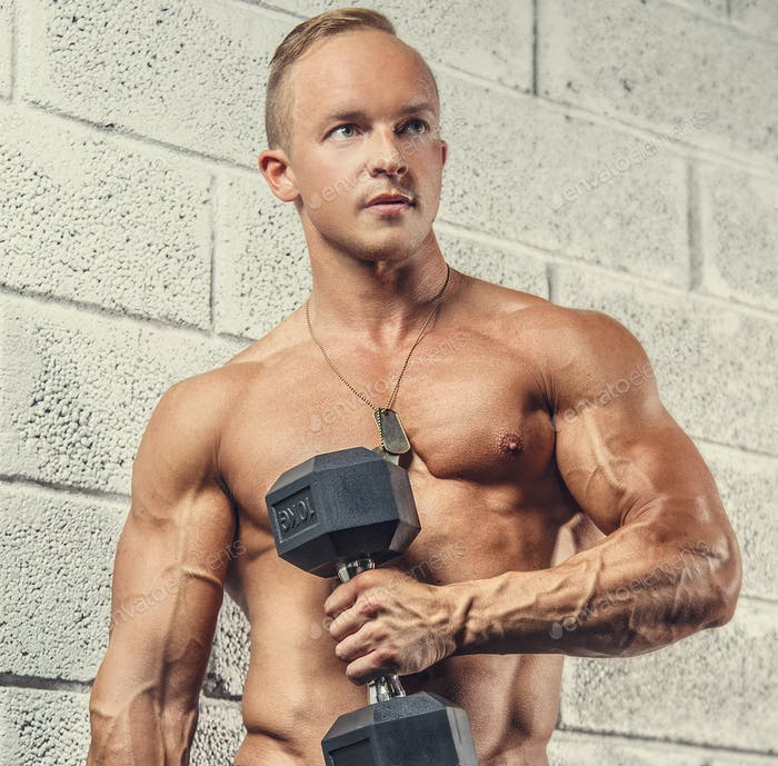 Shirtless muscular guy with dumbells