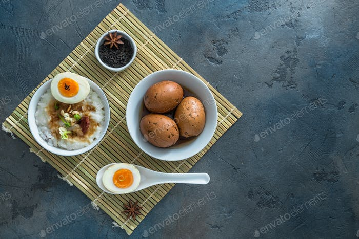 Chinese breakfast with rice porrige and tea eggs, place for text