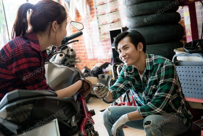 Couple are repair a motorcycle