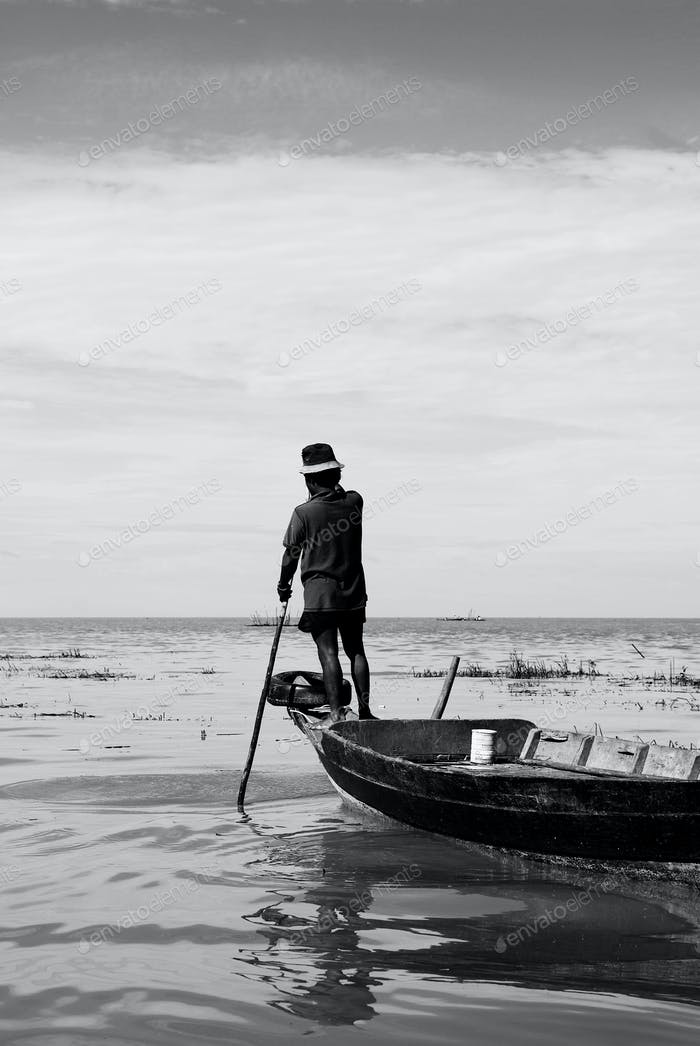 Cambodian Native Fisherman Rowing The Boat