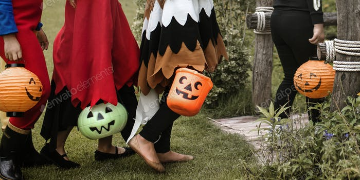 Thumbnail for Young kids trick or treating during Halloween