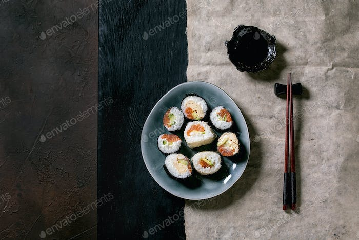 Homemade sushi rolls set with salmon, japanese omelette, avacado and soy sauce