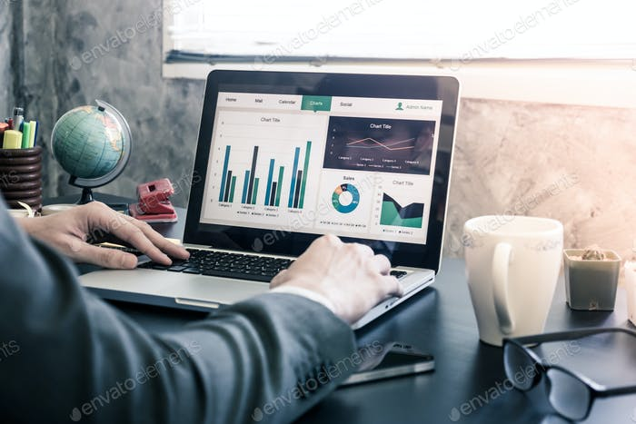 Businessman analyzing investment charts on the office desk.