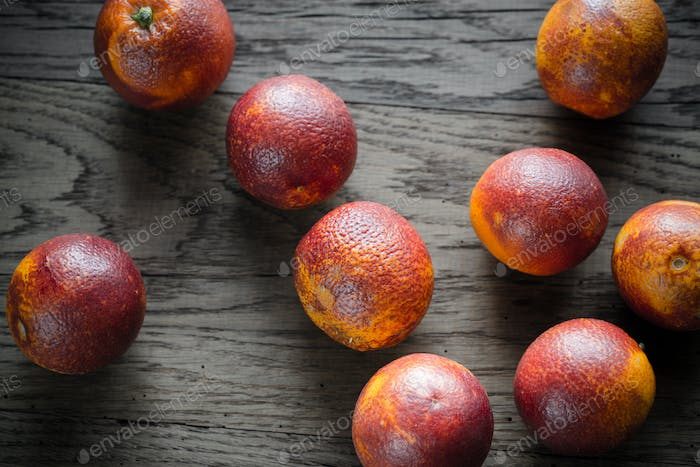 Red tangerines on the wooden background
