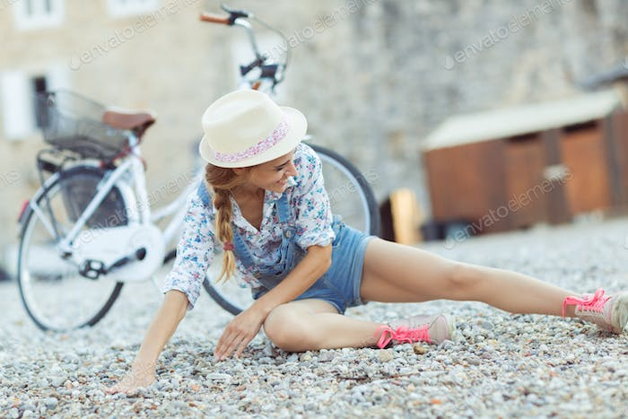 Beautiful woman with bycicle on the beach