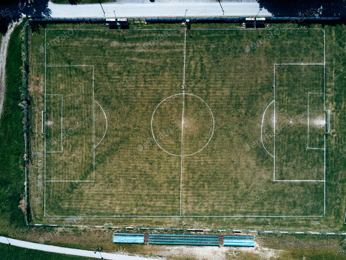 Aerial view of real soccer pitch, football field drone pov