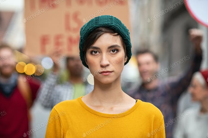 Determined young woman in protest
