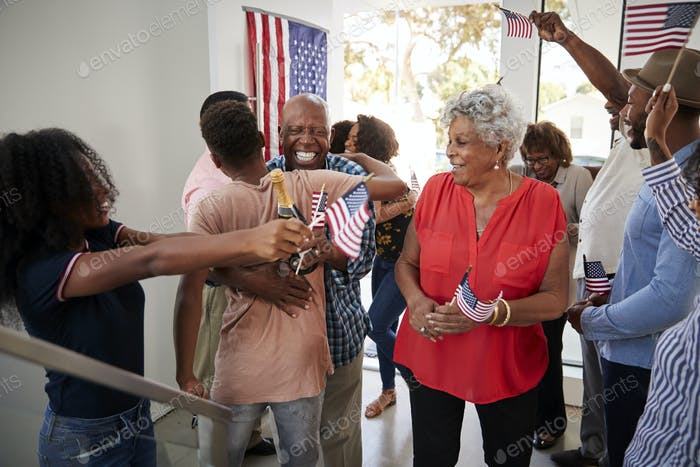 Three generation black family celebrating Independence Day at home together,close up